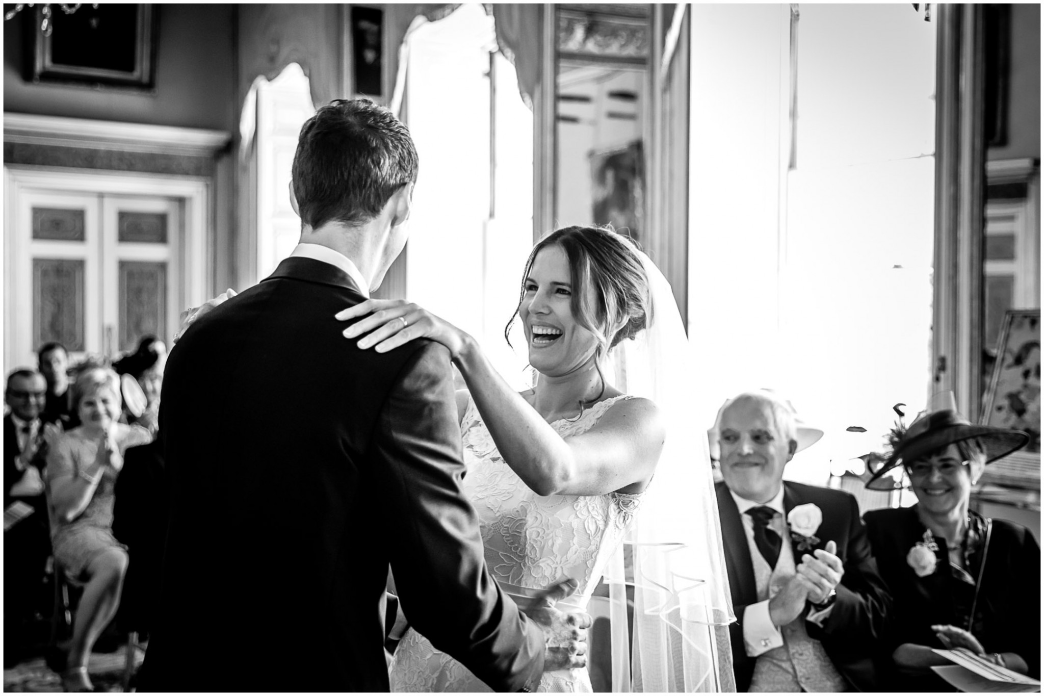 Avington Park Wedding Photographer Bride Laughing in Ceremony